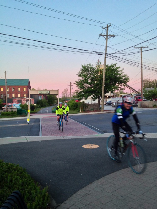 DEEP Commissioner Daniel Esty, DECD Commissioner Catherine Smith, and Bike-wizard Pete Salamone, downtoen Plantsville, CT @ 5:25am
